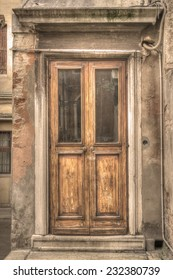 old wooden door in Venice, Italy. Processed for sepia tone effect.