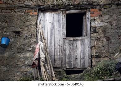 Old wooden door in a village, horizontal composition.