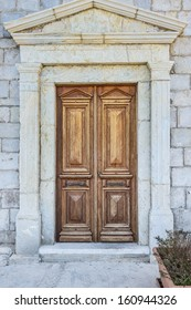 old wooden door in the wall of the building
