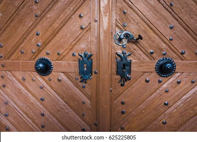 Old wooden doors with forged elements