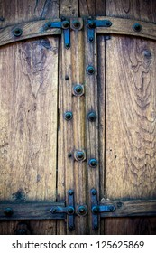 Old wooden double doors with iron work