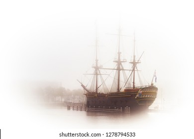 Old wooden dutch galleon in harbor. High key image of vintage battleship in a fog.