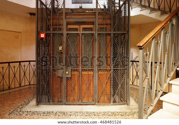 Old Wooden Elevator in a Metal Shaft
