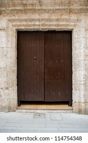 """Old wooden entrance door in Valladolid, """"Castilla y Leon"""", Spain."""