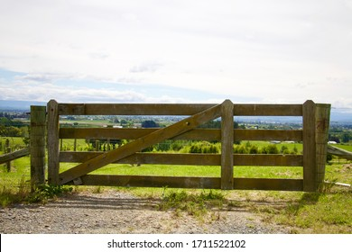 Old wooden farm gate overlooking New Zealand scenic landscape