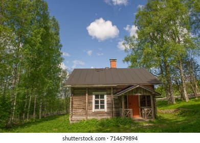 old wooden farm house in a rural setting in Finland