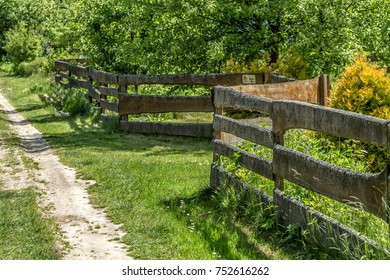 An old wooden fence near the village farmstead