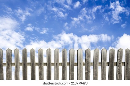 old wooden fence on a blue sky background