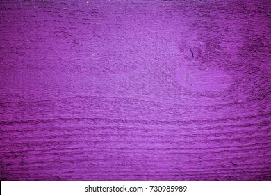 Old wooden fence pattern colored Purple - wood background. Wood texture painted violet closeup. Vintage wooden background with copy space