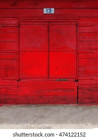 old wooden fence with red paint, wood texture. window