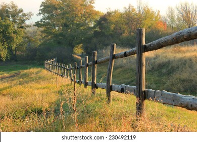Old wooden fence at rural countryside at dawn