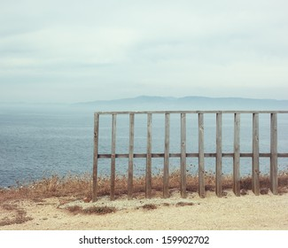 Old wooden fence and Sea