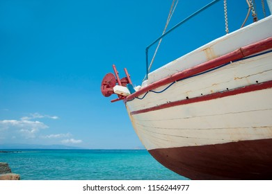 Old wooden fishing boat in a fishing village