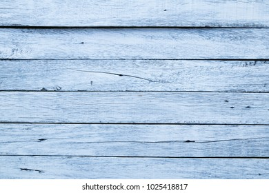 Old wooden floor arranged in black and white horizontal.