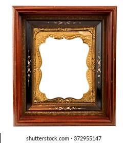 Old wooden frame with ornate Daguerreotype gold metal insert