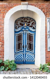 Old wooden front door in house in Luneburg. Germany