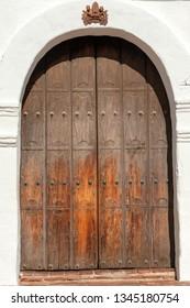 Old wooden front door of Spanish mission Basilica San Diego de Alcala, California, USA