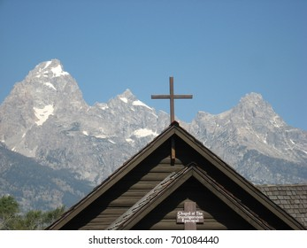 Old, wooden frontier church in front of the Grand Tetons