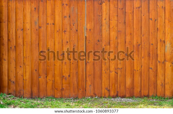 Old Wooden gate with door close up. Retro design.