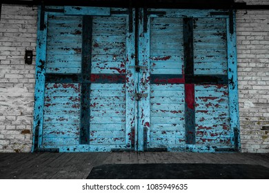 Old wooden gate with faded paint