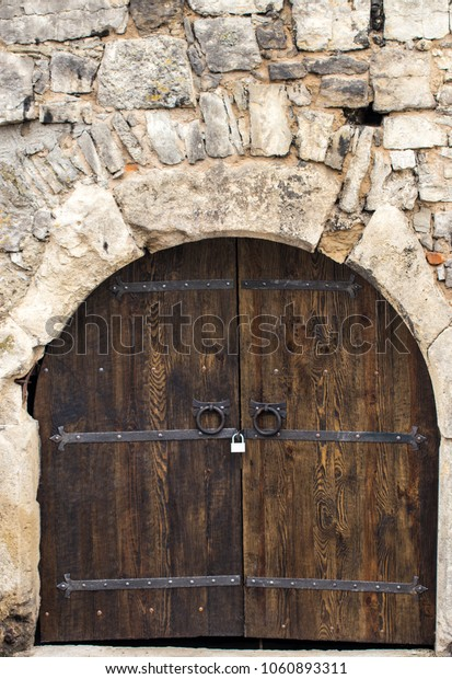 Old Wooden gate with metal decoration close up.