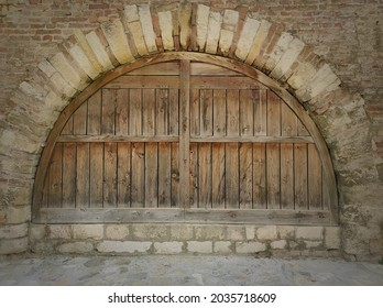 Old wooden gate.Old wooden gate at the opening with an arched vault.