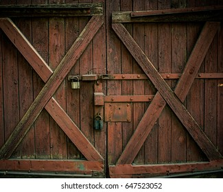 Old Wooden Gate With Padlocks. Retro design.