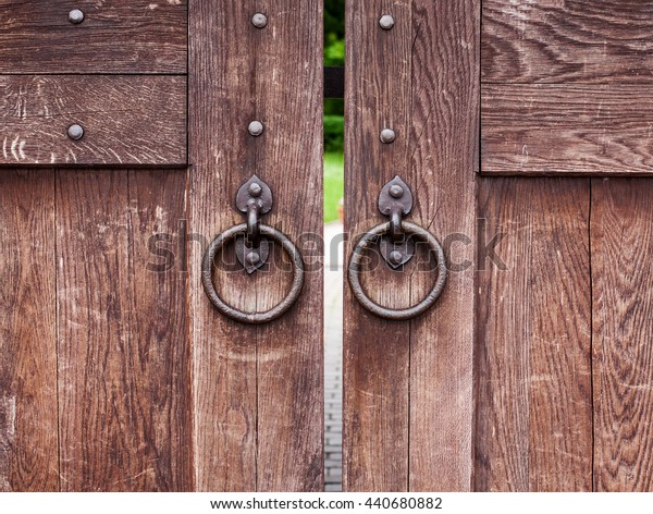 Old wooden gate with rings, closeup shot