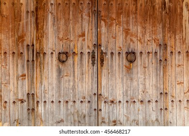 Old wooden gates with iron handles,Wooden gates