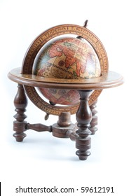 Old wooden globe on wood stand showing Europe on isolated white background.