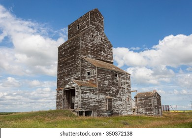 Old Wooden Grain Elevator with Blue Sky and Clouds