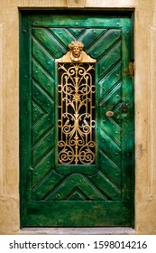 Old wooden green door with a latch rusty lock in Bamberg, Bavaria, Germany.