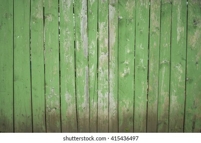 Old wooden green fence. Wood texture. Green background.