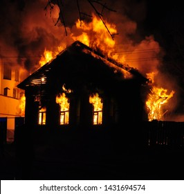 An old Wooden house burning in the fire