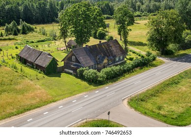 old wooden house by the road
