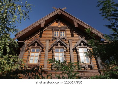 Old wooden house with carved windows in Astrakhan city (Russia). House of merchant Tetyushinov