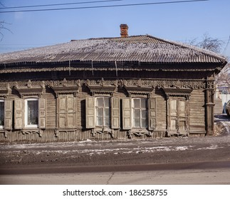 Old wooden house in Irkutsk woodcarvings Slavonic guardian symbols, runes guardian.