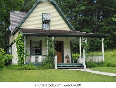 old wooden house with large porch