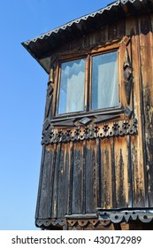 Old wooden house. Window. Angle. Blue sky