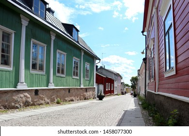 Old wooden houses along the street of Porvoo old town in summer. Idyllic scene. Old Porvoo is one the most picturesque places in southern Finland