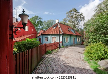 Old wooden houses on narrow historical street in Scandinavian city. Colorful countryside of Gothenburg, Sweden.