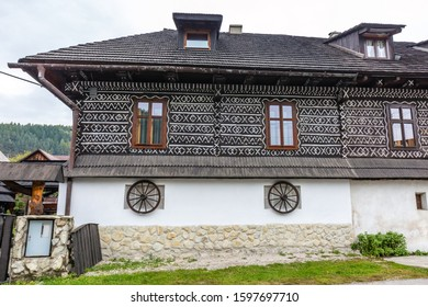 Old wooden houses in Slovakia village Cicmany in autumn. Unique decoration of log houses based on patterns used in traditional embroidery in village of Cicmany, UNESCO World Heritage Site, Slovakia