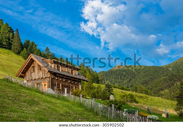Old wooden hut cabin in mountain alps