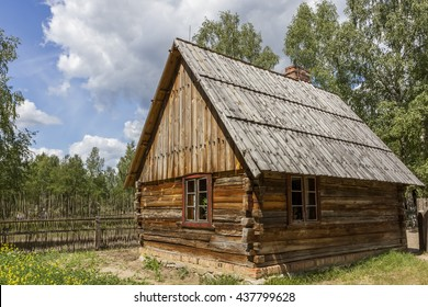 Old wooden hut with a fence