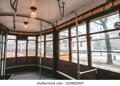 Old wooden interior of tramway in Milan, Italy