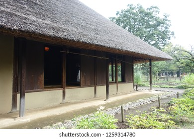 Old wooden Japanese house with thatched roof