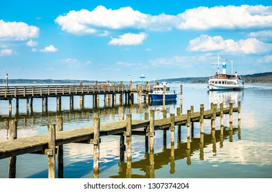 old wooden jetty at the ammersee lake - bavaria