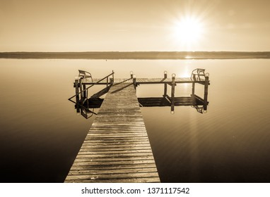 old wooden jetty at the ammersee lake - herrsching