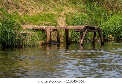 old wooden jetty by the river