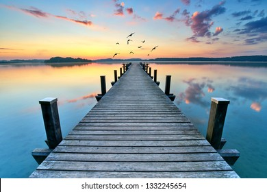 old wooden jetty in the morning, magic light in sunrise